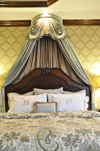 Master bedroom custom bedding and wall finishes